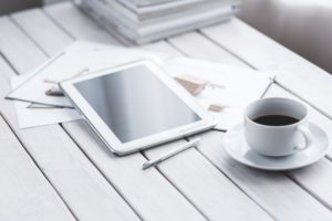 white-tablet-and-cup-of-coffee-6337