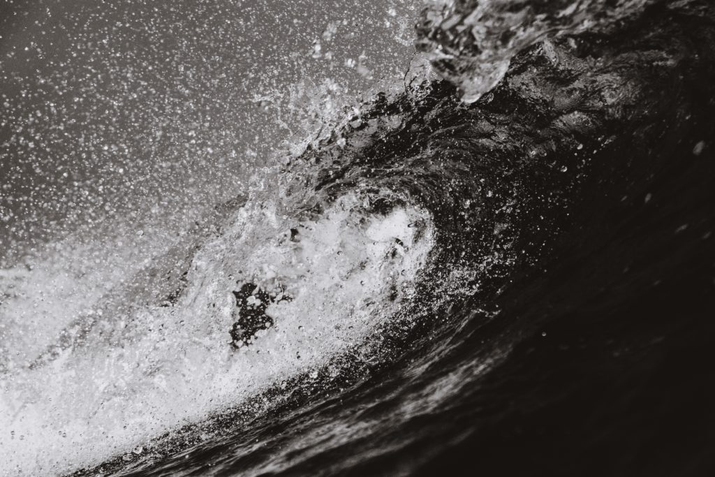 grayscale-photo-of-sea-waves-1536314
